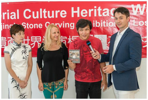 Don The Dragon Wilson presents his film «The Martial Arts Kid» at the Yang Jing Jing Exhibition (Yang Jingjin, Daisy Lang, Don The Dragon Wilson, Victor Migalchan